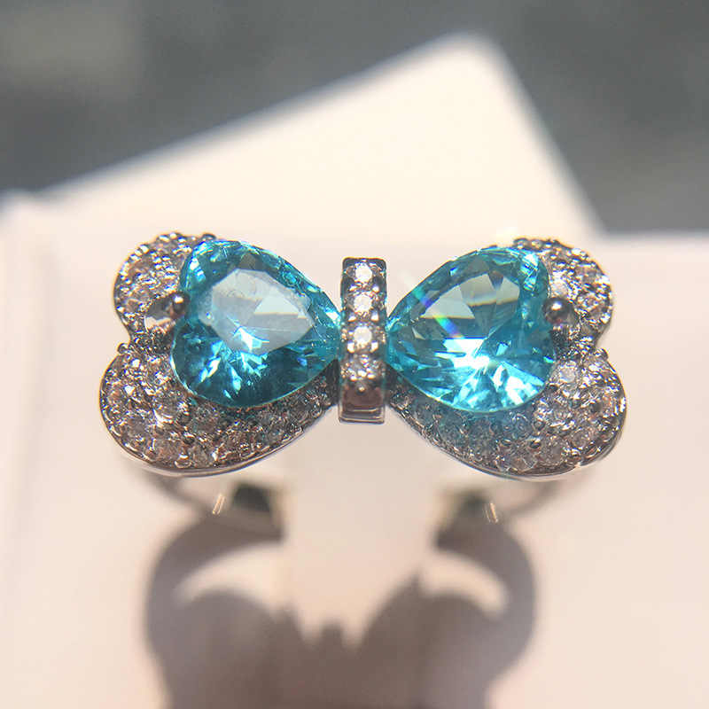 Aqua azul Zirconia cúbica cristal CZ Color plata anillos boda Bowknot para mujeres niñas regalo joyería al por mayor anillo de Aguamarina