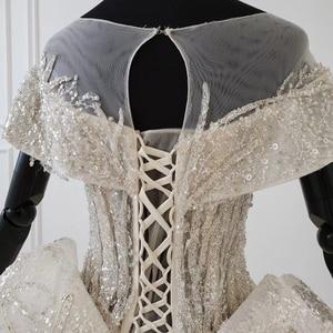 Image 5 - HTL1137 shiny hochzeit kleid capped hülse oansatz spitze up korsett brautkleider rüschen zug ins heißer verkauf sparkly vestidos novia