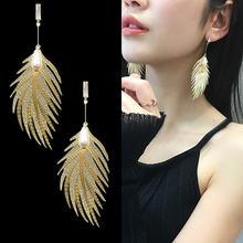 Корейские серьги с золотыми перьями длинные висячие перламутровым