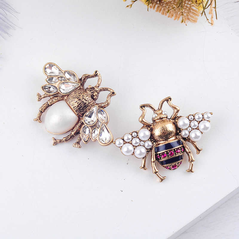 Bohemia Baru Kecenderungan Fashion Imitasi Mutiara Merah/Putih Warna Kaca Bee Serangga Bros untuk Wanita Laporan Perhiasan Grosir