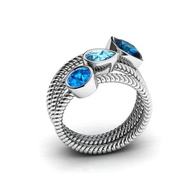 Фото женский набор обручальных колец серебряных с голубым цирконием цена