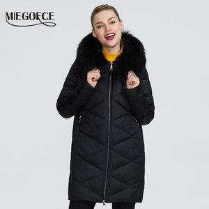 Image 1 - MIEGOFCE 2019 Новая зимняя женская коллекция курток куртка женская зимняя необычайный дизайн имеется капюшон с мехом длина до колена теплая женская куртка биопух сохраняет тепло и придает легкость