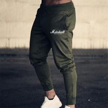 Spodnie do joggingu mężczyźni do biegania siłownia spodnie treningowe odzież sportowa biegaczy spodnie sportowe męskie spodnie do biegania spodnie do biegania Jogging spodnie męskie tanie tanio FITNESS MUSCLE Sznurek COTTON Poliester Jogging Pants Men running GYM Bieganie Pasuje prawda na wymiar weź swój normalny rozmiar