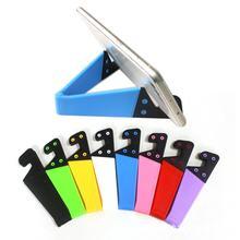 Baixo preço universal desktop dobrável v-em forma de suporte do telefone móvel colorido v-shaped preguiçoso base de suporte