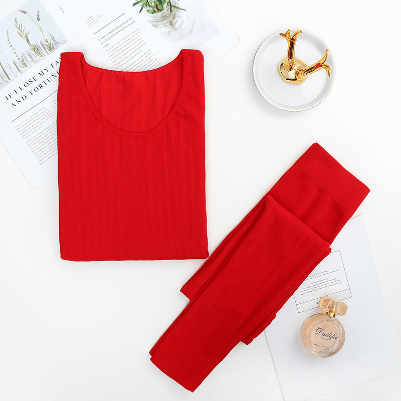 Fashion Autumn And Winter New Women's Knitted Thermal Underwear Set Round Neck Close-fitting Breathable Hips Long Johns