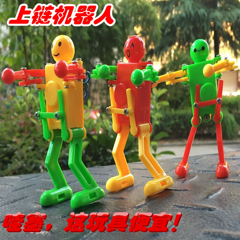 Stall Hot Selling Small Toy Spring Robot Dancing Robot Torsion Butt Winding Toy