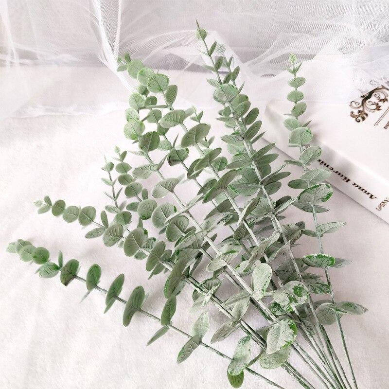 Alta qualidade de plástico eucalipto folhas falso planta folha decoração flor material casamento flor parede decoração para casa planta vegetação