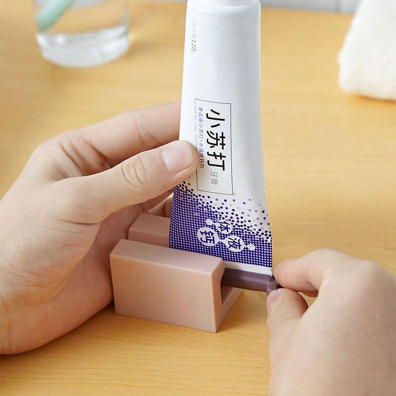 Bathroom Toothpaste Squeezer Easy Dispenser Rolling Holder Toothpaste Holder Bathroom Tool freeshipping