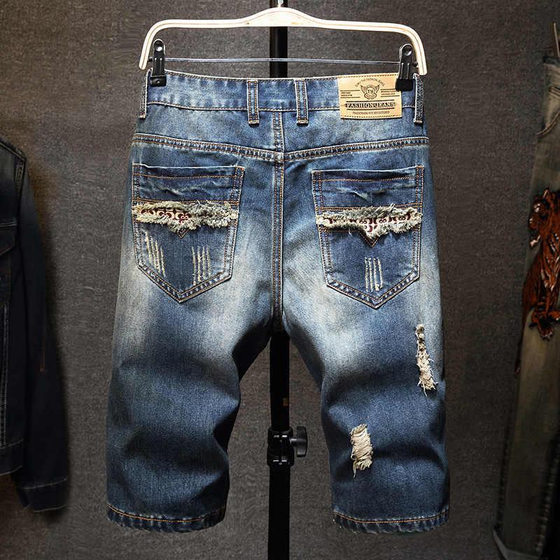 Yeni erkekler vintage yırtık bermuda kot kısa yaz Streetwear Hip hop erkek delikler düz Denim şort artı boyutu 40