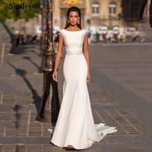 Свадебное платье с юбкой годе рукавами и открытой спиной