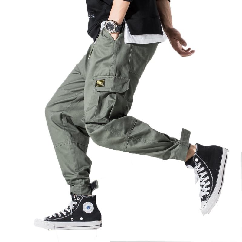 2020 Men Multi-pocket Cargo Pants Mens Design Elastic Waist Harem Pant Street Punk Hip Hop Casual Male Army Trousers Joggers 5XL