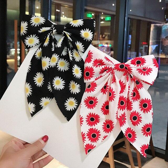 Фото новинка корейский большой бант шпилька для волос подсолнух ласточка цена