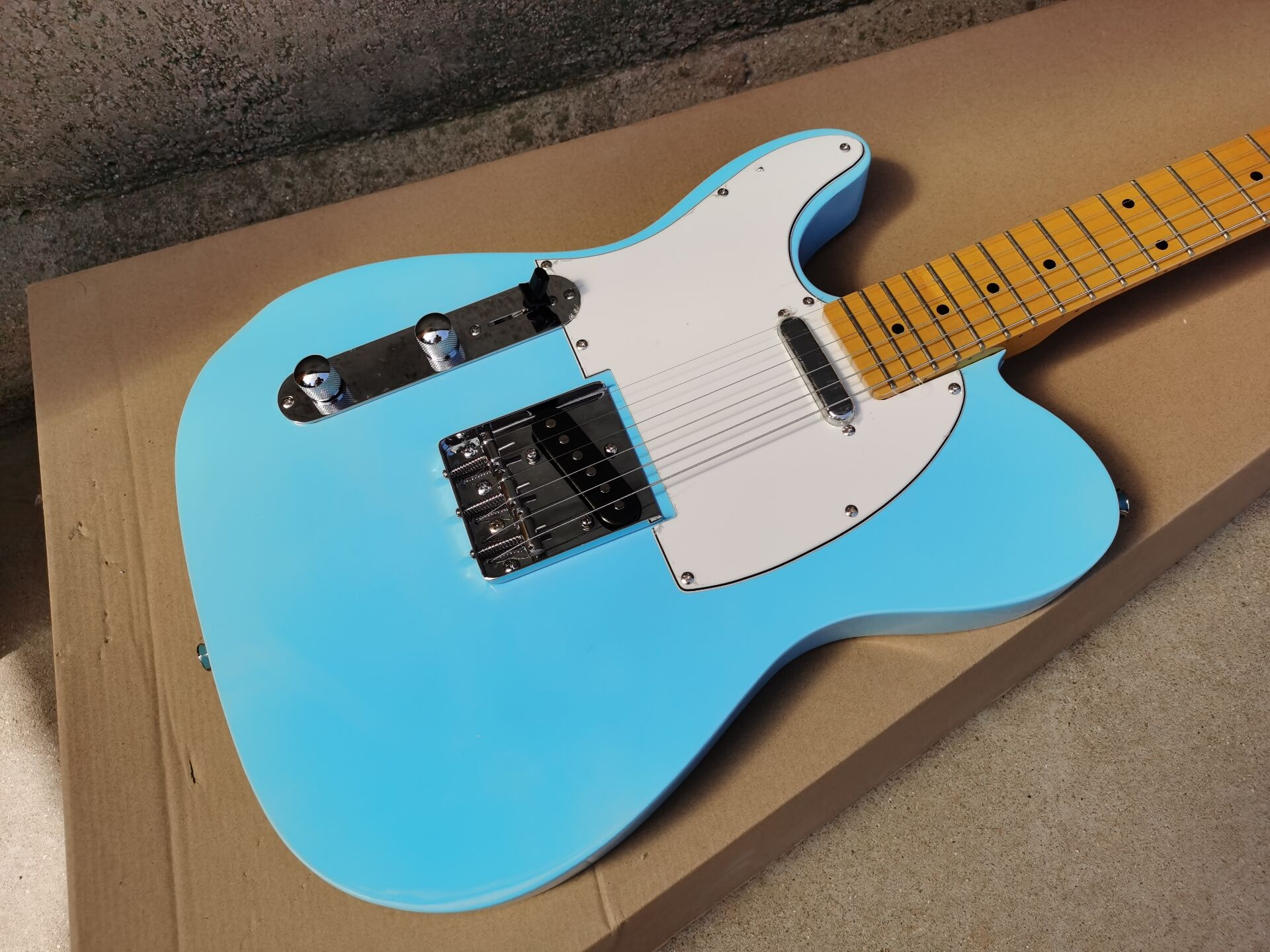 Chinese guitar factory custom TL light blue Left Handed Electric Guitar with White Pickguard high quality free shipping 9