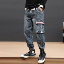 цена Autumn Fashion Streetwear Men Jeans High Quality Loose Fit Designer Pockets Cargo Pants Harem Trousers Hip Hop Jogger Jeans Men