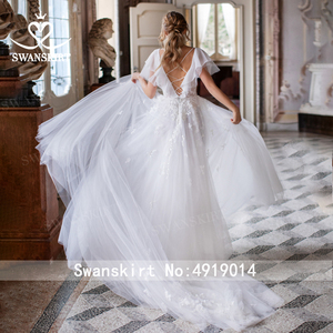 Image 3 - Boho Illusion Wedding Dress V neck Appliques A Line Lace up Court Train Swanskirt D109 Bridal Gown Princess Vestido de novia