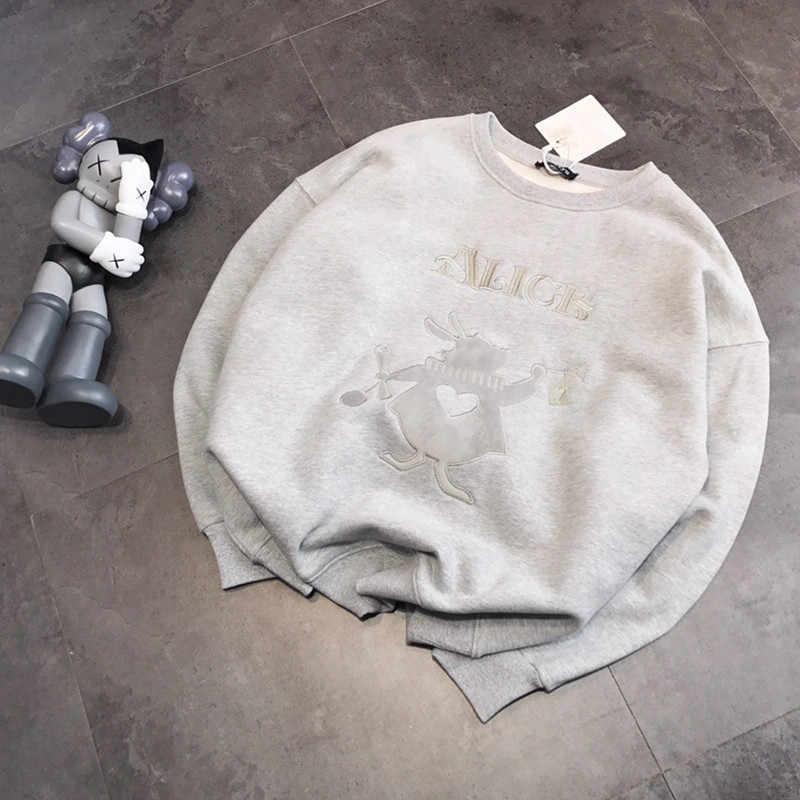 Autumn and winter 19 new cute embroidery bunny peach heart loose plus velvet sweater Korean women