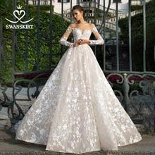 Eleganckie aplikacje koronkowa suknia ślubna Swanskirt I228 Sweetheart z długim rękawem linia Illusion suknia ślubna typu princeska Vestido de novia
