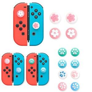 Image 1 - Carino Zampa di Gatto Artiglio Sakura Thumb Stick Grip Cappuccio Joystick Copertura Per Nintend Interruttore Lite Joy Con Controller Gamepad thumbstick Caso