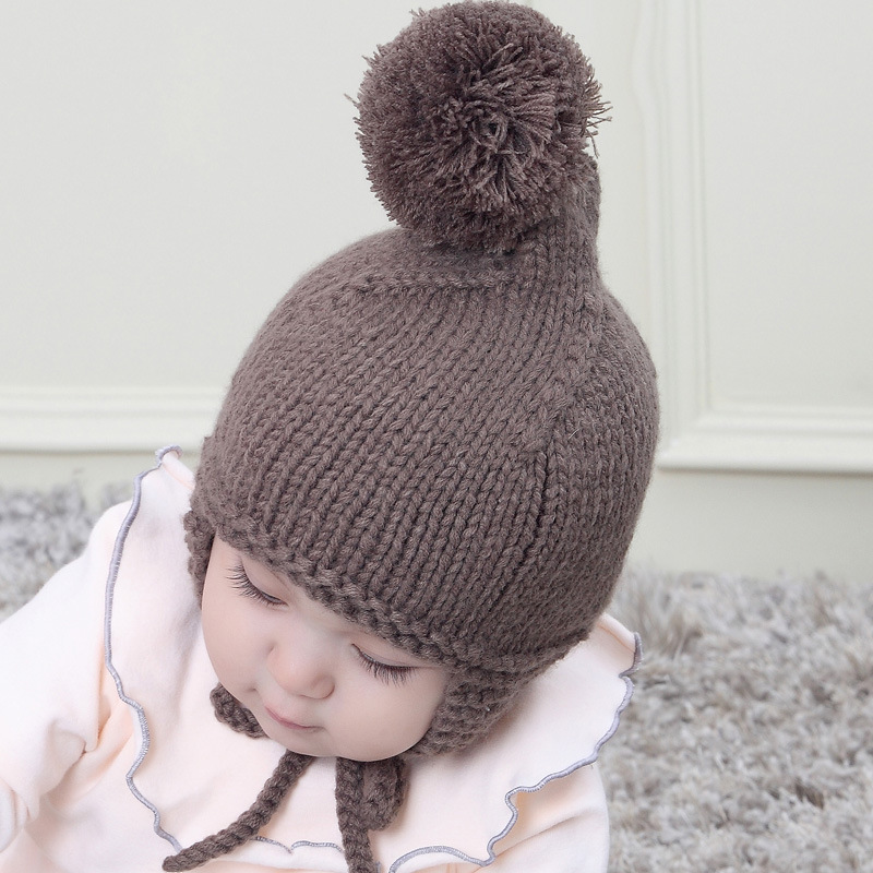 Winter Hats Children Baby Big Ball Knit Beanie Hat Warm Lovely Beanies Ear Protection Ties Baby Boys and Girls Caps Wholesale in Men 39 s Skullies amp Beanies from Apparel Accessories