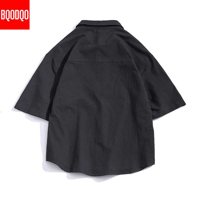 Camicie Casual a maniche corte bianche in stile giapponese uomo nero moda sciolto Top uomo camicia sociale estiva militare in cotone oversize maschile