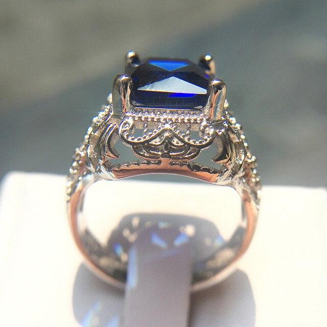 Фото женское винтажное кольцо из серебра 2019 пробы с синим цирконом