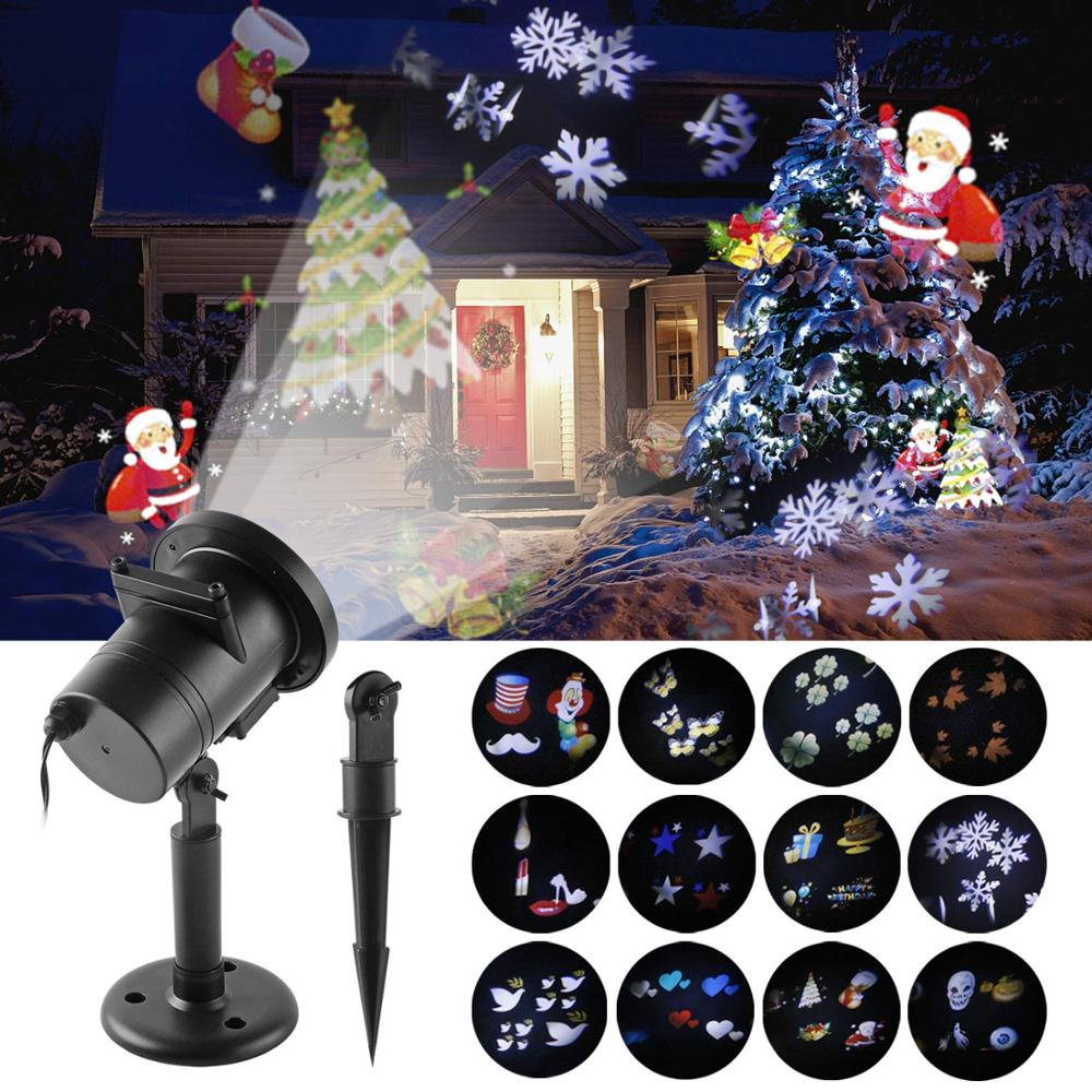 12 modelli Proiettore di Natale Luci laser a LED Impermeabile Fiocco di neve Festa di Capodanno Decorazione domestica Lampade da giardino