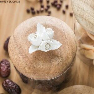 Image 4 - İskandinav yaratıcı seramik çiçek kahve çekirdeği şeker mühürlü kavanoz dekoratif cam kavanoz mutfak büyük saklama kavanozları ahşap kapaklı