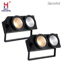 https://ae01.alicdn.com/kf/H436fc078e194413782fe2bc0c6120137R/Professional-2x100W-LED-blinder-light-2eye-COB-LED-Light-High-power-DMX-Stage.jpg