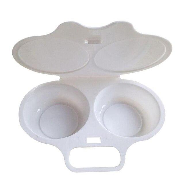 Photo du cuiseur oeuf micro onde tupperware qui est ouvert sur un fond blanc.