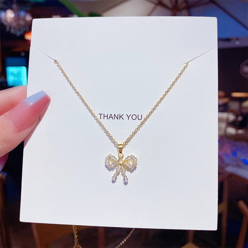 Zircon Bow Necklace Female Clavicle Chain Color Gold Pendant ins Cold Wind Jane Niche Design Necklace