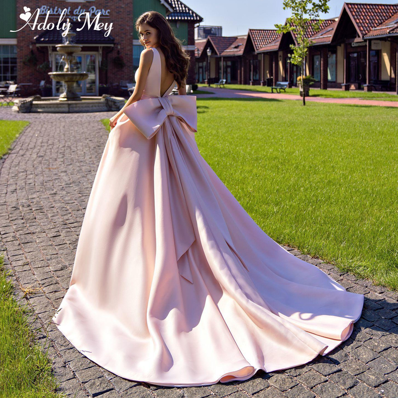 Adoly Mey New Arrival Sexy V-Neck Backless Pink A-Line Wedding Dress 2020 Elegant Big Bow Satin Court Train Princess Bridal Gown