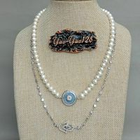 19'' 2 Strands Cultured White Pearl CZ Pave Hamsa Charm Necklace