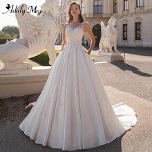 Adoly Mey Design charmant col en v bouton Satin a ligne robe de mariée 2020 luxe perlé Appliques Court Train Vintage robe de mariée