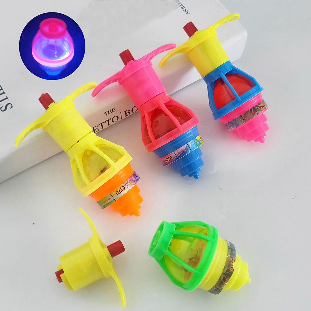4Pcs Kids Gyroscope Toy LED Flashing Light Peg Top Music Gyroscope Kids Toy Rapid Rotation For Party Supplies(China)