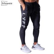 Siteweie novas calças esportivas dos homens correndo ginásio de algodão calças lápis joggers casual fitness sports sweatpants musculação l249