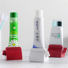 Rolling Toothpaste Dispenser Holder Multifunctional Plastic Facial Cleanser Squeezer Tooth Paste Tube Press for Bathroom