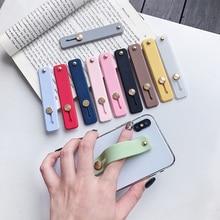 Banda de muñeca de Color liso banda de mano agarre de dedo soporte de teléfono móvil Push Pull Universal soporte de enchufe de teléfono para Iphone