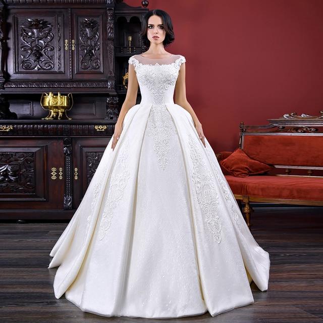 فساتين زفاف فساتين زفاف 2020 Vestido De Noiva Princesa ذات أكمام قصيرة بأربطة مطرز بالخرز لؤلؤ مزين فستان رائع