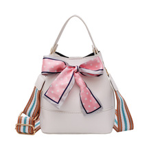 2017 new female bag bucket bag korean simple fashion satchel all match bulk bag Bucket bag woman 2019 new bow knot rope pulling bag fashion Korean version of one shoulder inclined bag simple woman bag