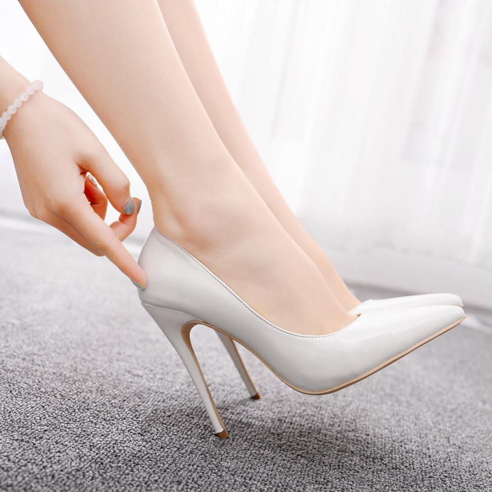 Crystal Queen Hot Selling White Patent Leather High Heel Sexy Pointed Toe Thin Heels Woman Pumps Dress Heels Woman Wedding Shoes