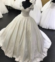 Liyuke Customize Made A Line Wedding dress according to Customer #8217 s request Custom fee PLEASE CONTACT US BEFORE BUYING cheap Strapless Sleeveless Satin Sweep Brush Train Floor-Length zipper Wedding Dresses Appliques Backless 0401 Natural Suzhou