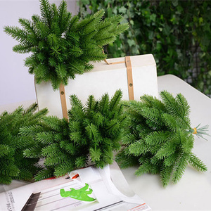Image 1 - 50Pcs Artificial Pine tree branches plastic pine leaves for Christmas party decoration faux foliage fake flower DIY craft wreath