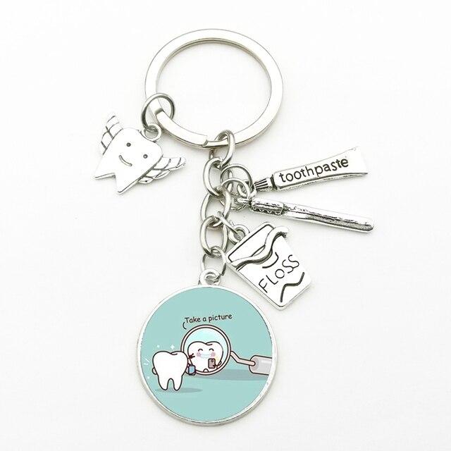 New Creative Dental Tooth Pendant Key Chain Cute Dental Floss Box Angel Dentist Charm Keychain Men Women Gifts Fashion Souvenirs