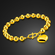 New contracted golden heart-shaped pendant bracelet.Fashionable woman rose gold round bead bracelet.Charming lady jewelry
