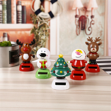 цена на Cute Cartoon Christmas Solar Car Shaking Head Ornaments Ornaments Elk Snowman Elderly Children Shaking Head Toys