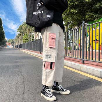 Hip-hopowe spodnie dresowe hafty styl japoński spodnie dresowe Streetwear mężczyźni biegacze spodnie dresowe na co dzień tanie i dobre opinie Cztery pory roku Spodnie cargo CN (pochodzenie) POLIESTER COTTON Daily HIP HOP Mieszkanie Z KIESZENIAMI LOOSE 28 - 40 1424