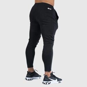 Image 3 - רצים מכנסי טרנינג Mens Slim מכנסי קזואל מוצק צבע חדרי כושר אימון כותנה ספורט סתיו זכר כושר קרוספיט מסלול מכנסיים
