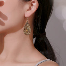 Bohemian metal dripping pattern earrings national style peacock tail retro carved personality earrings earrings(China)