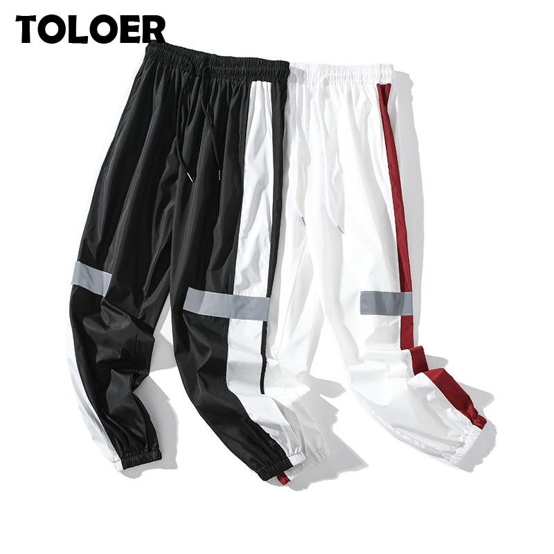 Men Streetwear Reflective Joggers Pants 2020 Man Korean Fashion Hip Hop Sweatpants Couple Side Striped Harem Sport Trousers Male