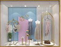 Clothes shop window props are hanging display rack gold creative umbrella hat stand on the floor
